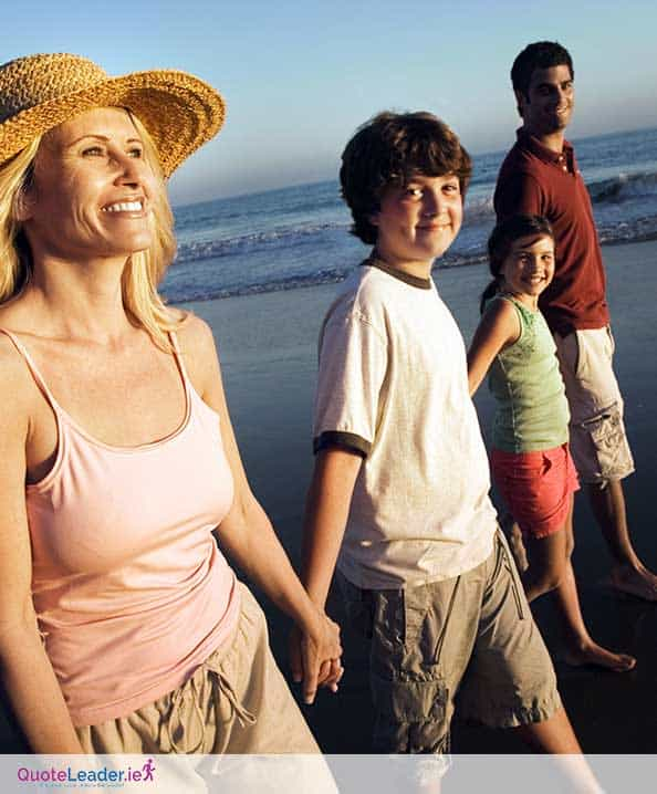 happy family with life insurance booked are walking down the beach